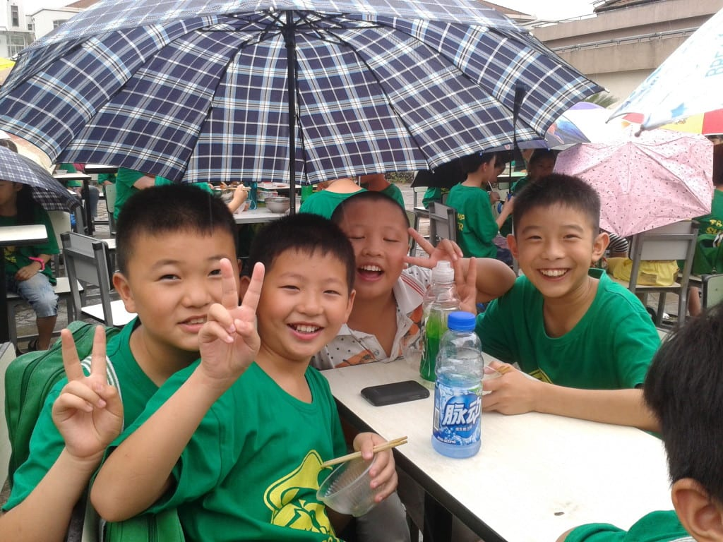 School students in teach English in China summer camp happy